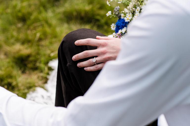 bride's hand on husband's knee