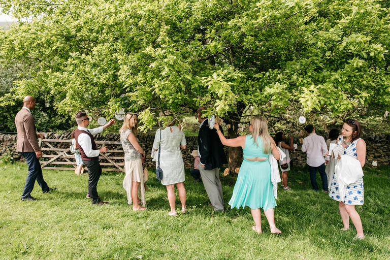 guests looking at tree favours