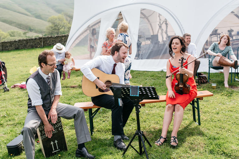 three piece band playing a wedding