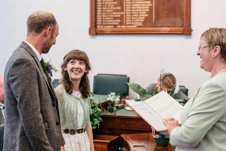 smiling bride during vows