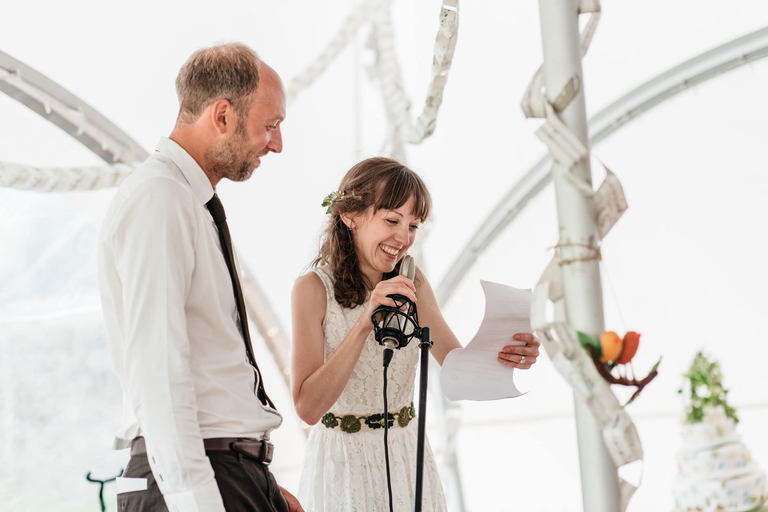 bride and groom giving a speech together