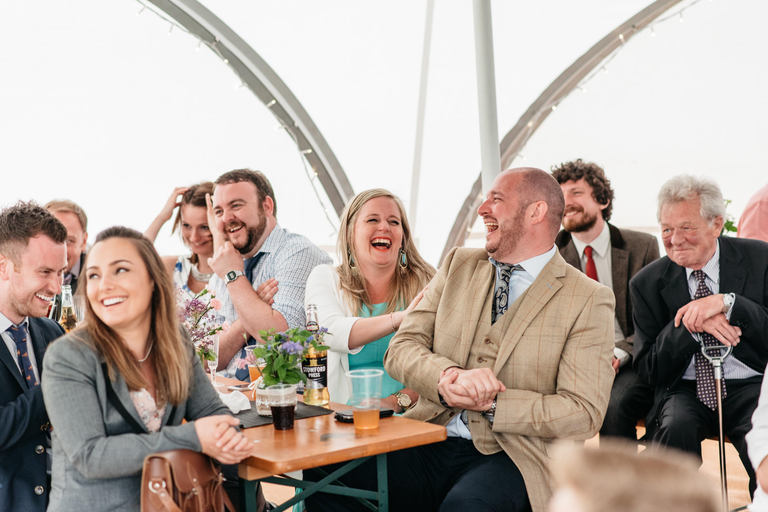 guests laughing in marquee