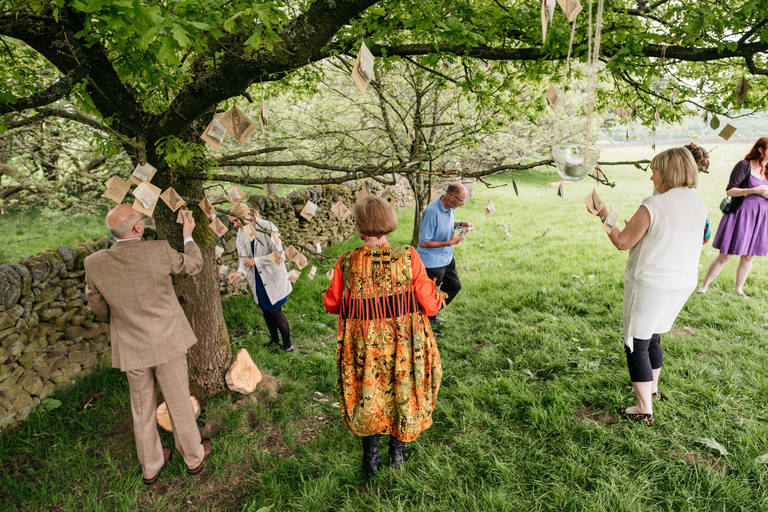guests finding their favours in the tree