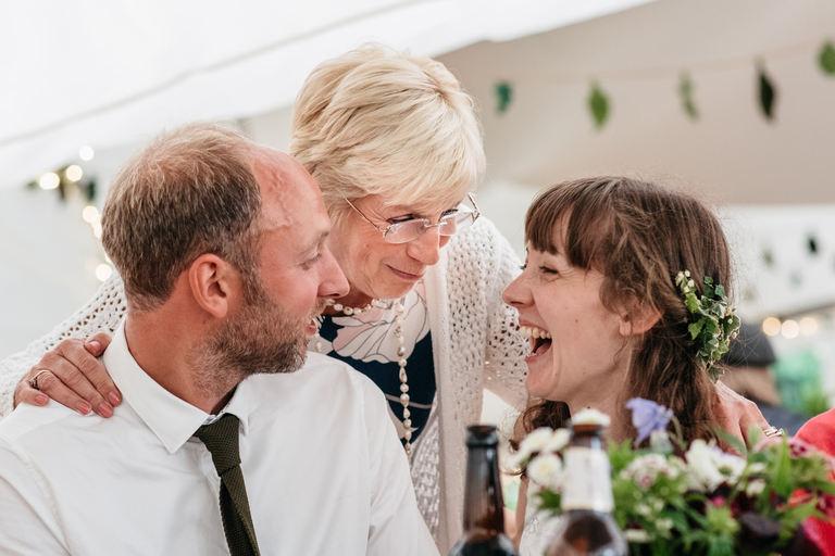 guest tells bride and groom a joke