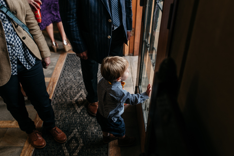 little boy watching bride arrive