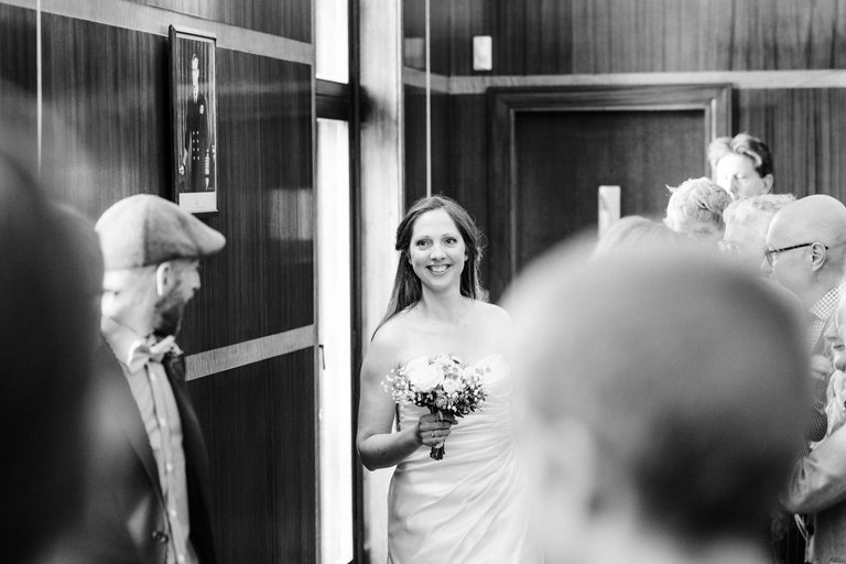 smiling bride arriving