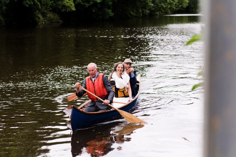 bride and groom canoeing to venue