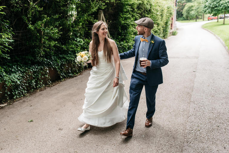 bride and groom walk through darley park