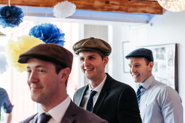 wedding guests with flat caps