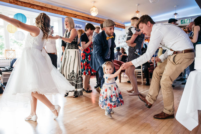 wedding guests dancing with kids