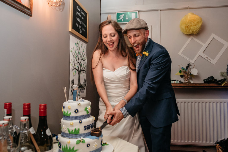 bride and groom cut the diy cake