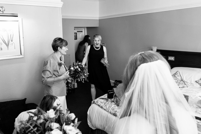bride's friend sees her in her dress for the first time