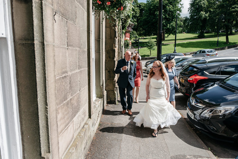 bride walking to the wedding venue in buxton