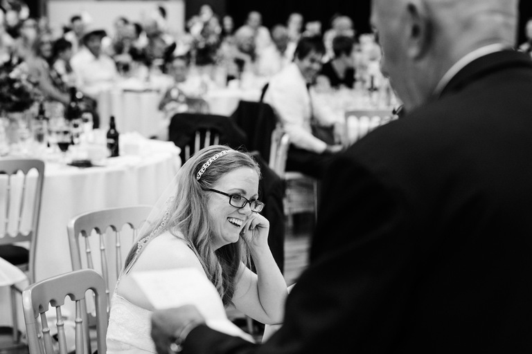 bride laughing during her father's speech