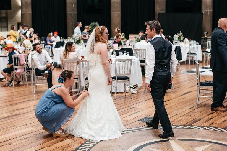 adjusting the dress