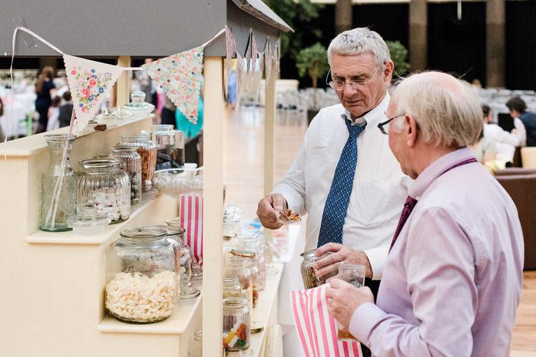 elderly gentleman raiding the sweet cart