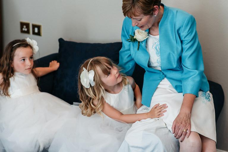 little flower girl with her grandma