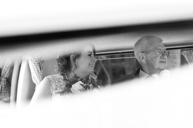 bride arriving in a camper van with her father