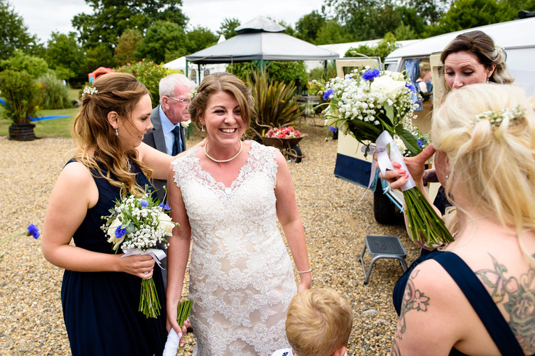 excited bride arrives at the wedding venue