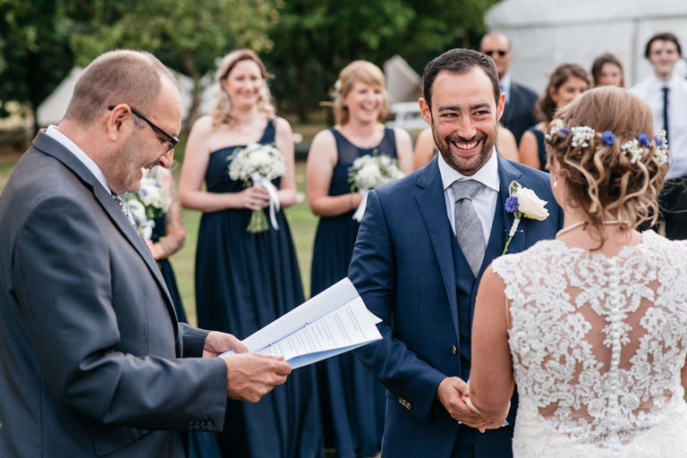 happiest groom during vows