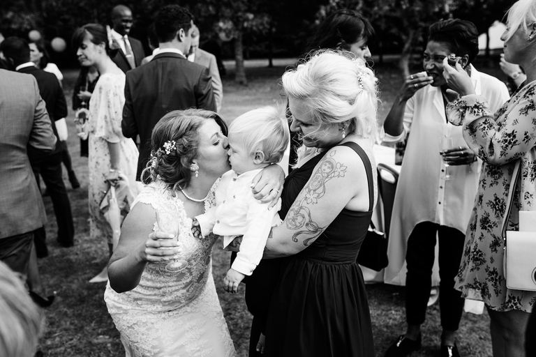 bride kissing her best friend's baby