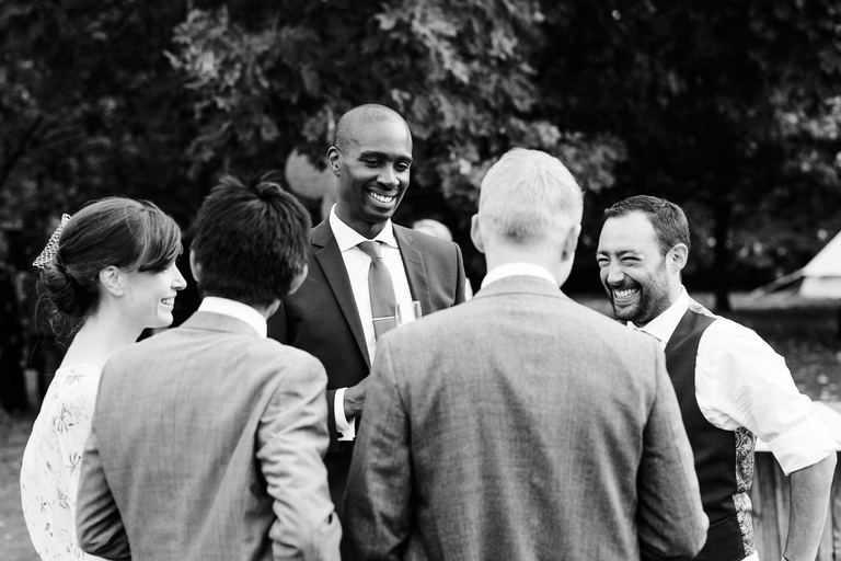 groom sharing a joke with friends