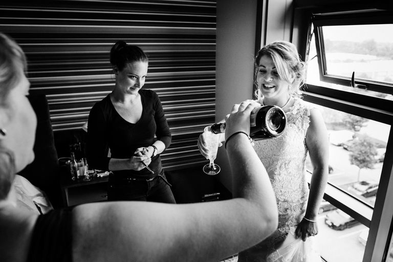 bride having a glass of champagne