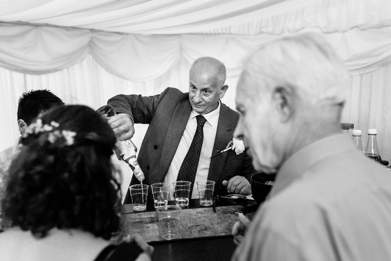 father of the bride pouring shots