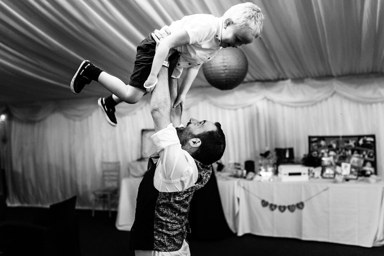 groom playing with a young guest