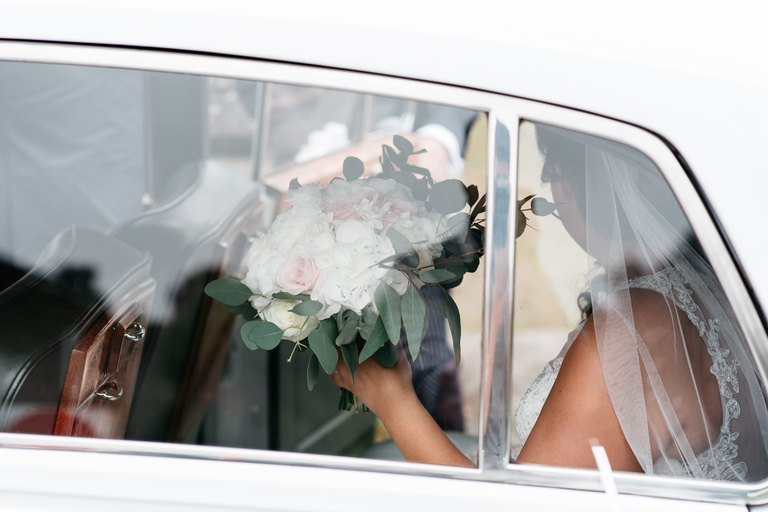 bride's bouquet through her car window