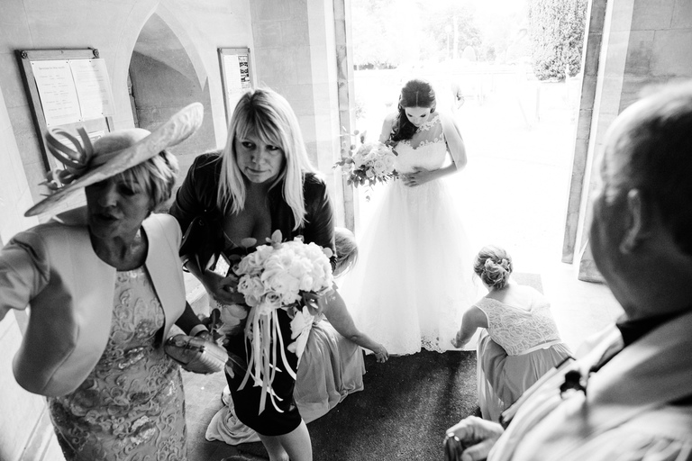 bride calms her nerves at the church door
