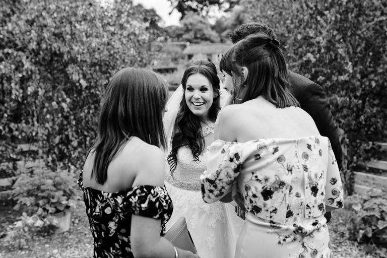 smiling bride sharing a joke with friends