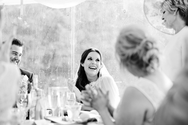 bride laughing at her mum's speech