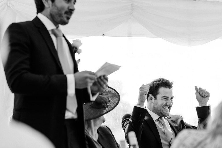 groom celebrating during best man's speech