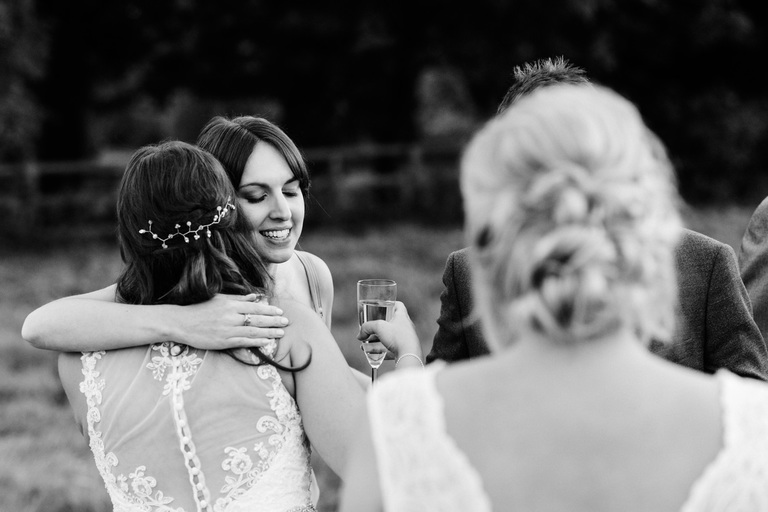 guest gives bride a hug