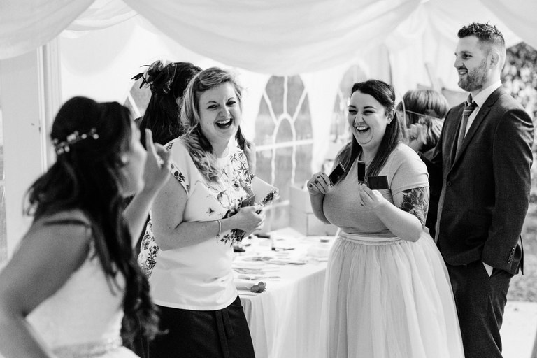 bride joking with wedding guests