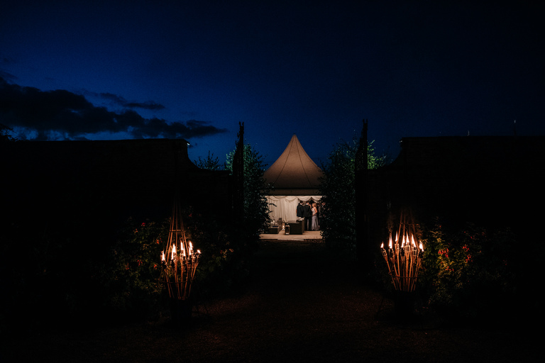 giant candles and marquee at night
