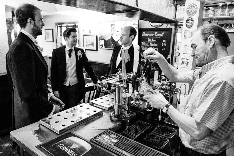 Groom having a drink in the pub before the ceremony