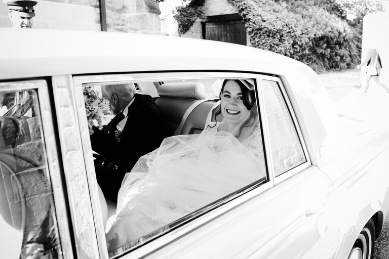 Bride and her father arrive at the church