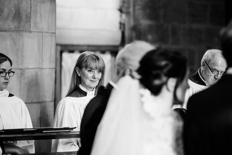 Member of the choir looking at the bride