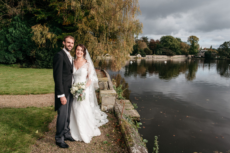 Relaxed wedding portrait at Melbourne Pool in Derbyshire