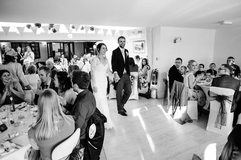 Newlyweds are announced into their wedding breakfast