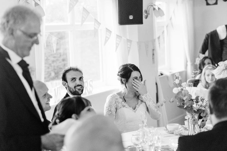 Bride wipes her eyes during her dad's speech