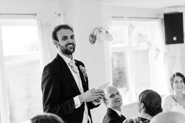 Smiling groom giving his speech