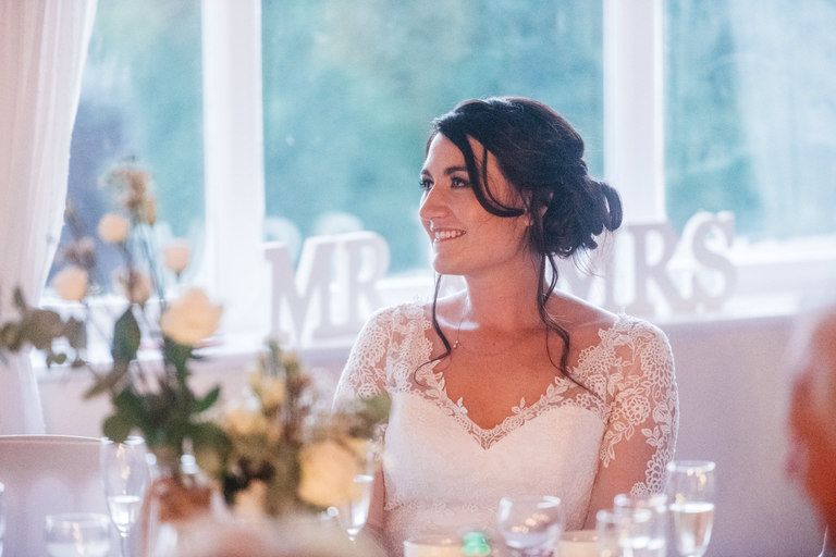 Happy bride looking lovingly at her husband
