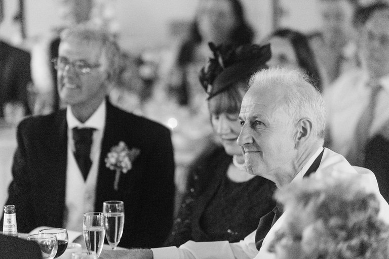 Father of the bride holding back tears
