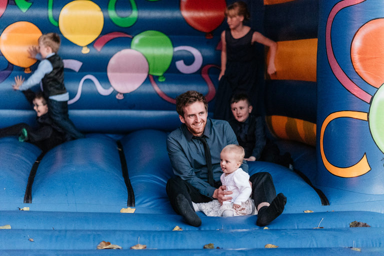 A guest on the bouncy castle with his child