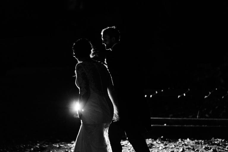 Rim light around the bride and groom at night