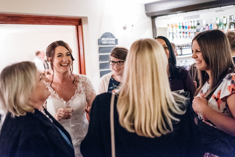 Bride greeting her friends at the evening reception