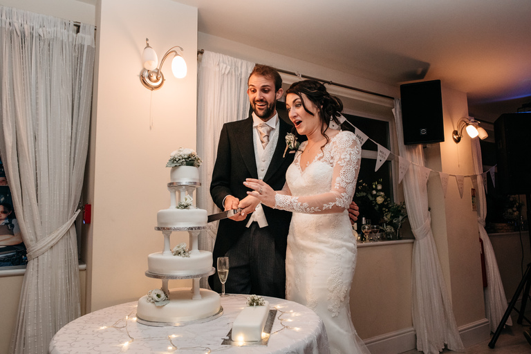 Shocked faces as the couple cut the cake